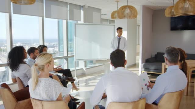 Doctor Making Presentation To Medical Staff In Hospital - vídeo