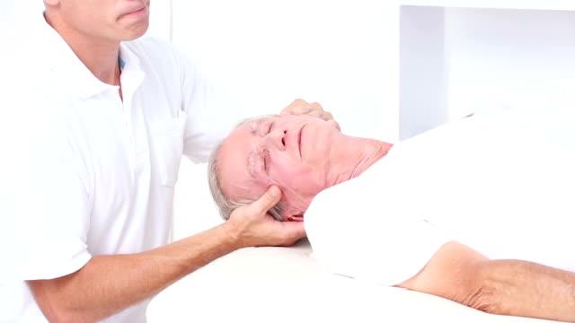 Doctor massaging his patients head video