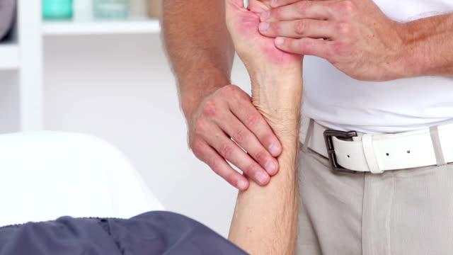 Doctor massaging his patients wrist video
