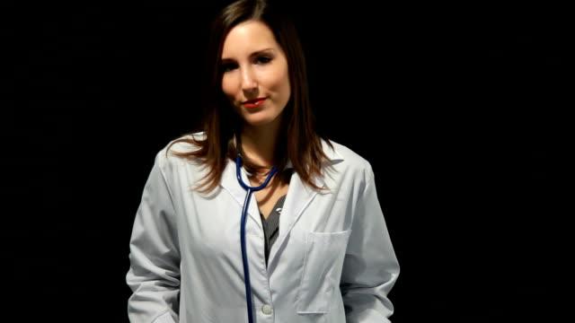 Doctor on black background video