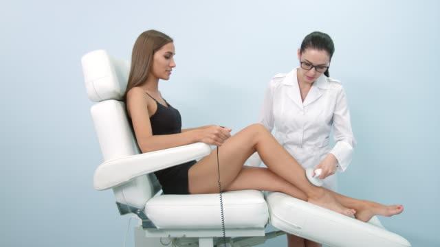 Doctor performing electrostatic massage procedure video