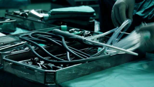 Doctor prepares probe for laparoscopic surgery Doctor prepares probe for laparoscopic surgery surgical equipment stock videos & royalty-free footage