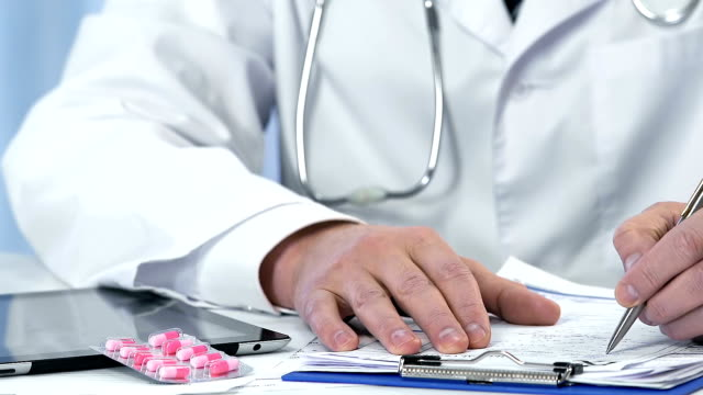 Doctor prescribing hormones and giving pills to female patient, gynecology video