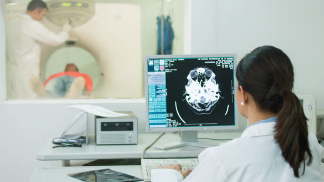 doctor reading a cat scan - apparecchiatura medica video stock e b–roll
