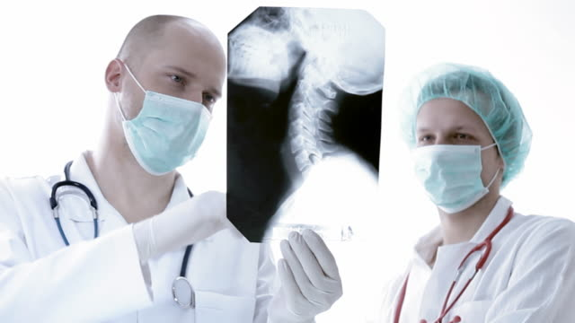 Doctor reviews x-ray video