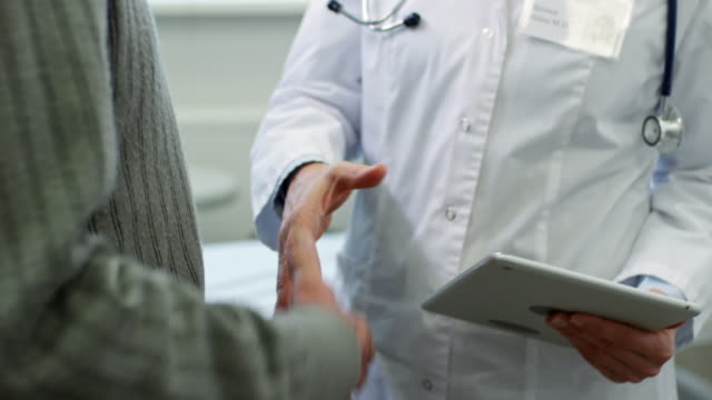 Doctor Shaking Hands with Male Patient video