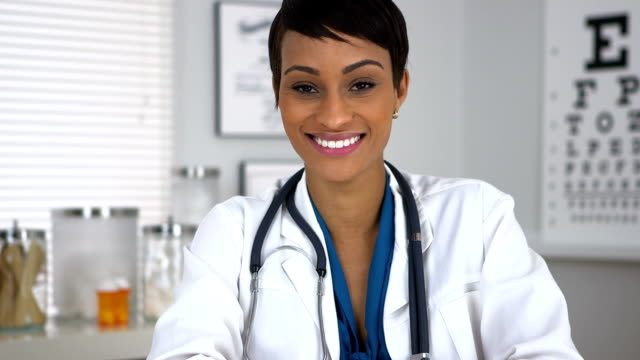 Doctor sitting at desk in office video