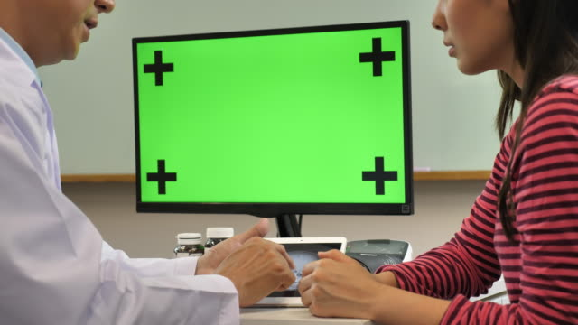 Doctor Talking His Patient With Computer Green Screen Stock