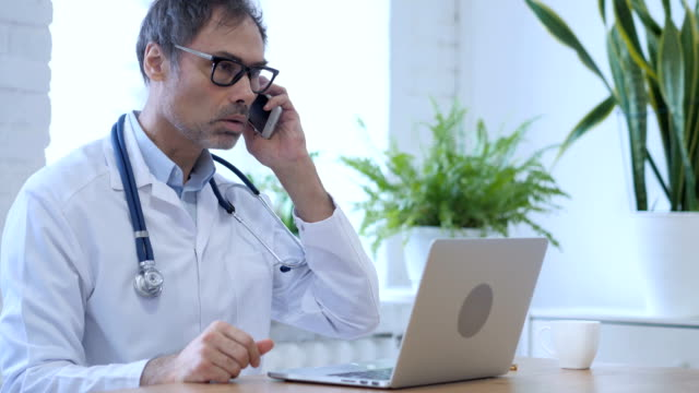 Doctor Talking on Phone with Patient, Discussing Health Issues video