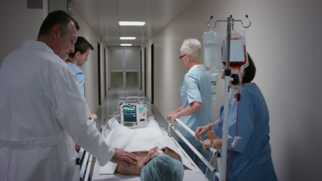 DS Doctor talking to his patient on the way to the operation room video