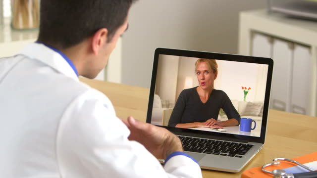 Doctor talking to patient through the internet video