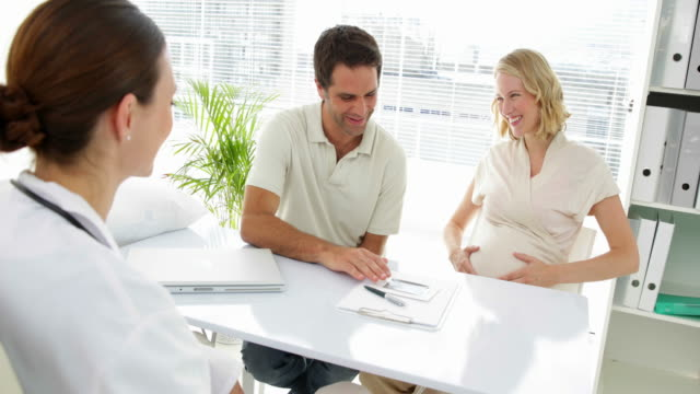 Doctor talking with expectant parents video