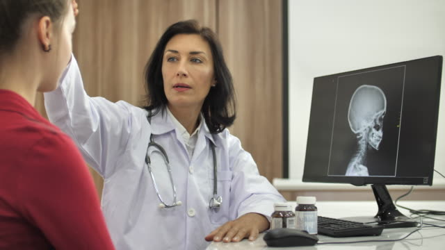 Doctor talking with patient about headache