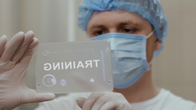 Doctor uses tablet with text Training