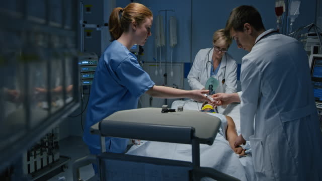 Doctor using a manual resuscitator on a patient in the intensive care video