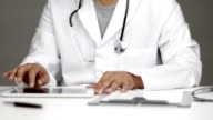 istock Doctor using touchpad on his desk 1165238705