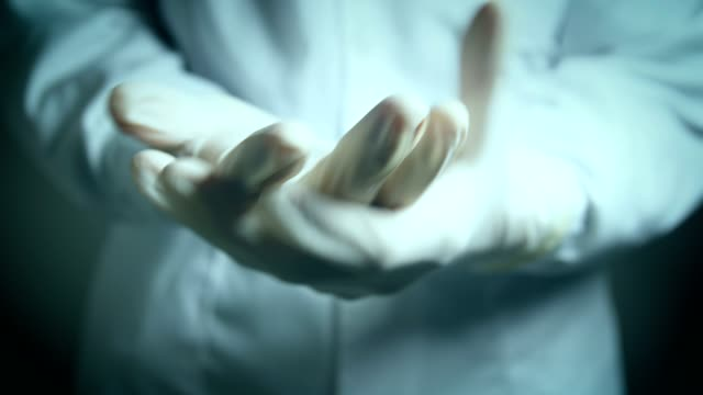 Doctor wearing with medical gloves Doctor wearing with medical gloves glove stock videos & royalty-free footage