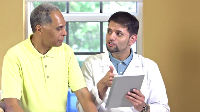 Doctor with digital tablet talking to patient video
