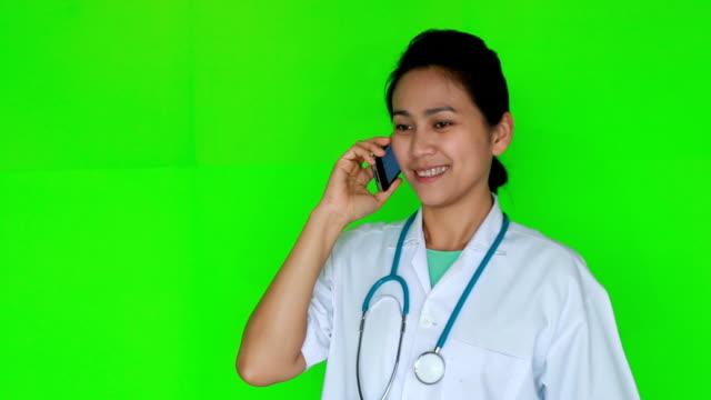 Doctor women talking telephone on green screen video
