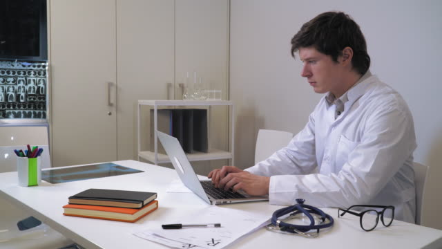 Doctor working on computer video