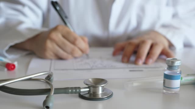 doctor works working at desk, hands of doctor panning shot doctor works working at desk, hands of doctor panning shot prescription stock videos & royalty-free footage