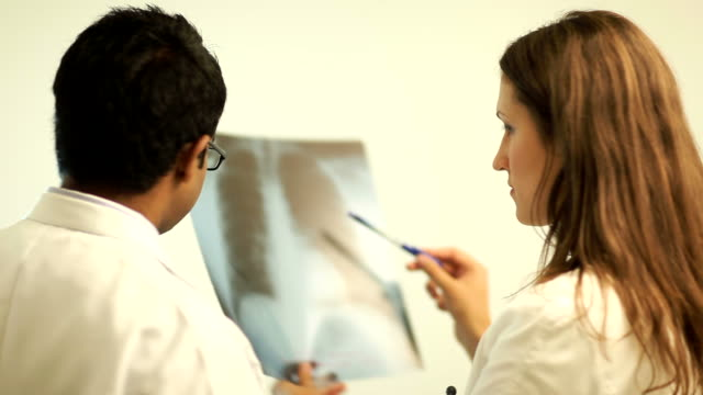 Doctors consults over an X-ray Images video