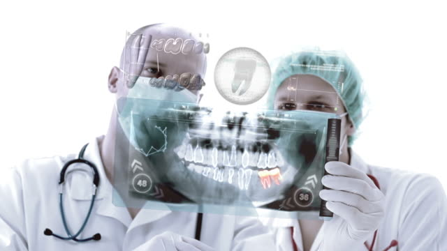 Doctors evaluate x-ray. Animation. video
