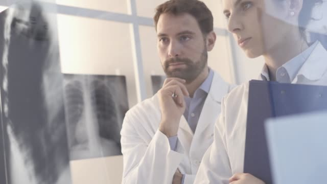 Doctors examining a patient's x-ray Doctors examining a patient's x-ray and discussing the diagnosis and the treatment, medical assistance and healthcare concept lung stock videos & royalty-free footage