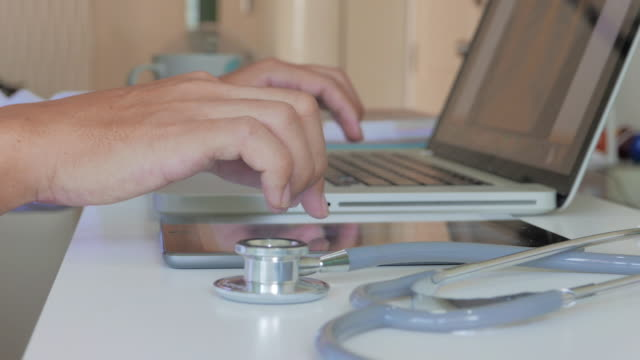Doctors examining x-ray image on a digital tablet and laptop video