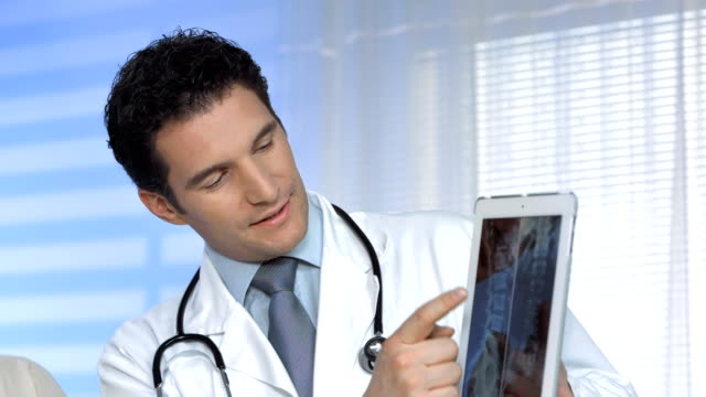 HD: Doctors Examining X-Ray Image On A Tablet video