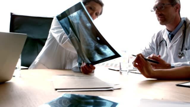 Doctors examining Xray scan video