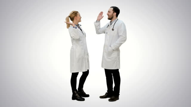 Doctors friends give each other five and thumb up on white background video