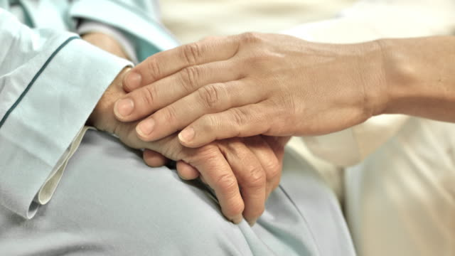 DS Doctors hand holding the senior womans hand video