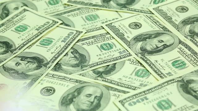 врач's руки расположены стетоскоп на доллары сша. поврежденные системы здравоохранения, - dollar bill стоковые видео и кадры b-roll