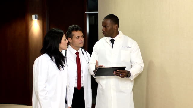 Doctors have Discussion Interacting with Digital Tablet - WS video