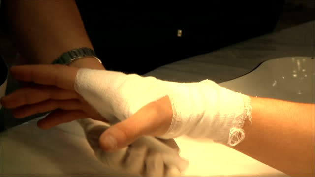 doctors impose a bandage on the patient's arm video