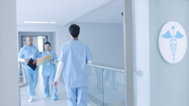 doctors in a hospital corridor 4k - stetoscopio video stock e b–roll