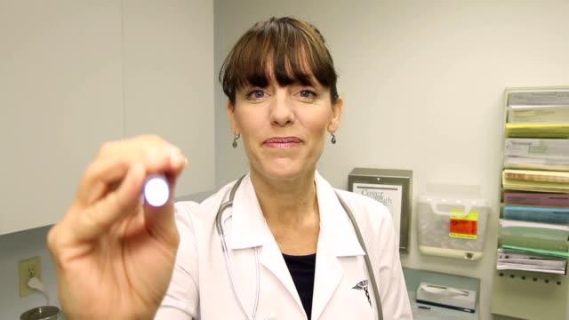 Doctor's Office Eye Exam Looks Good Shot in Colton, California in November 2012. eye exam stock videos & royalty-free footage