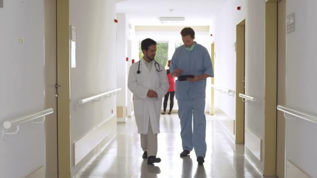 HD: Doctors Using A Digital Tablet video