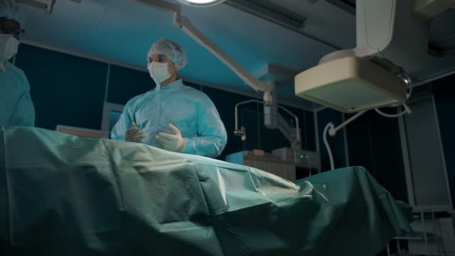 Doctors working in operating room in hospital