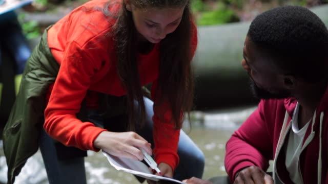 documenting her results - viaggio d'istruzione video stock e b–roll