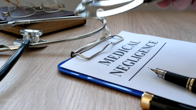 Documents about medical negligence, stethoscope and handcuffs. video