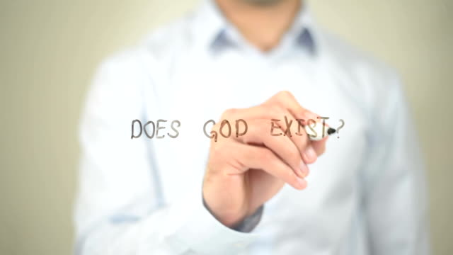 Does God Exist, Man writing on transparent screen video