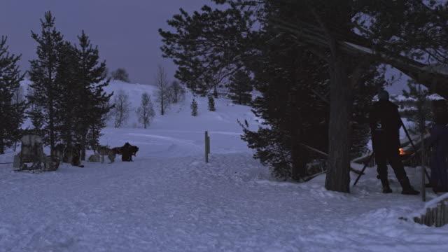 WS Dog sledder resting in a camp