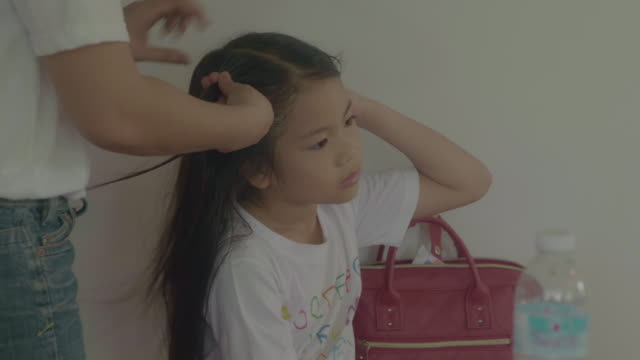 Doing Daughter's Hairs Avoidance  , COVID-19  , Stay at Home ponytail stock videos & royalty-free footage
