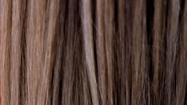 髪を延長 - 美容室のビデオ点の映像素材/bロール