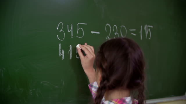 Doing Sums on Chalkboard video