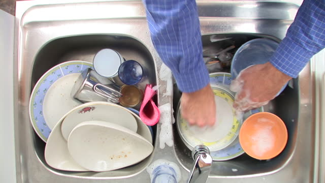 HD: Doing The Washing Up HD1080i: Close up high angle view of a man washing up the dishes. washing dishes stock videos & royalty-free footage