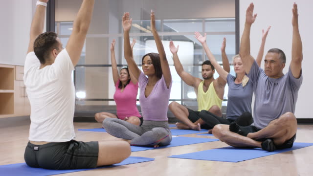 Doing Yoga in an Indoor Fitness Class video