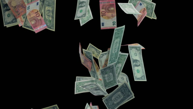 SLO MO Dollar and euro bills falling on black background